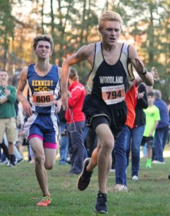 Woodland's Matthew Luxeder sprints to the finish line ahead of Kennedy's Alexander Brites during the Naugatuck Valley League cross country championship meet Oct. 18 at Veterans Park in Watertown. Luxeder finished fourth overall. The Woodland boys placed second. –ELIO GUGLIOTTI