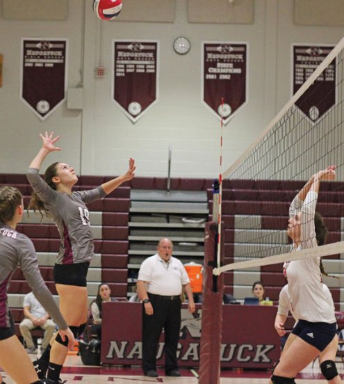 Naugatuck's Cailee Bergin (19) goes for the kill against Foran during the first round of the Class L tournament Monday at Naugatuck High School. –ELIO GUGLIOTTI