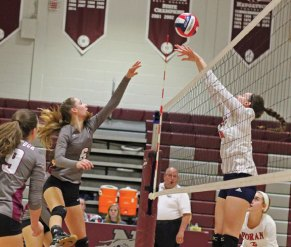 Naugatuck's Brielle Behuniak (6) hits the ball over the net against Foran during the first round of the Class L tournament Monday at Naugatuck High School. –ELIO GUGLIOTTI
