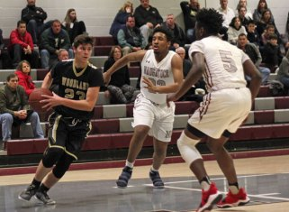 Woodland's Justin Marks (23) drives to the basket as Naugatuck's Jean Lukau (5) and Latrel Deveaux (23) defend Tuesday night at Naugatuck High School. Naugatuck won the game, 69-39. –ELIO GUGLIOTTI