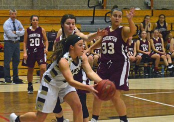 Woodland's Haley Andrews looks to pass down on the baseline against Torrington Jan. 12 at Woodland Regional High School in Beacon Falls. Woodland won the game, 56-47. –KEN MORSE