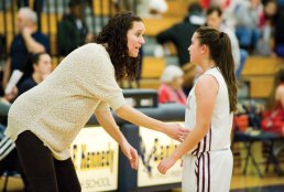 Naugatuck head coach Gail Cheney talks with Shannon Burns (5) during a break in the action against Wolcott in a NVL semifinal game Monday at Kennedy High School in Waterbury. Naugatuck won, 45-36. -JIM SHANNON/REPUBLICAN-AMERICAN