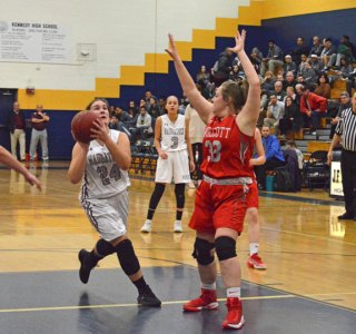 Naugatuck's Hailey Deitelbaum (24) takes it down the lane for a bucket against Wolcott in a NVL semifinal game Monday at Kennedy High School in Waterbury. Naugatuck won, 45-36. –KEN MORSE