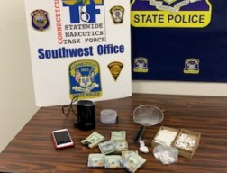 Police seized drugs, money, a handgun and other items after executing search warrants in Naugatuck and Bridgeport on Tuesday as part of an ongoing investigation. -CONTRIBUTED