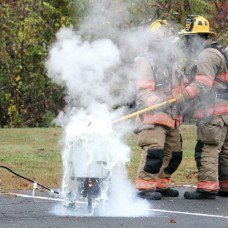 Boiling oil overflows as Lt. Matt Devan, left, and Lt. Dylan Sloss of the Prospect Volunteer Fire Department lowers a turkey into the pot while shooting a public service announcement Oct. 24 at the fire department. –ELIO GUGLIOTTI