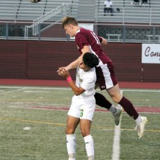 Naugatuck's Ryan Kenelly (12) goes up over Holy Cross' Aiden Coelho (6) to try to head the ball during a game Oct. 22 at Naugatuck High School. –ELIO GUGLIOTTI