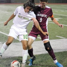 Naugatuck's Jay Barth (8) battles with Holy Cross' Guiseppe Mongeluzzc (10) during a game Oct. 22 at Naugatuck High School. Barth earned All-State and All-Iron Division honors for the fall season. –ELIO GUGLIOTTI