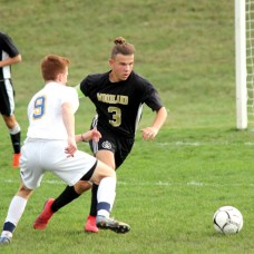 Woodland's Sean Hussey (3) weaves around Seymour's Jacek Inglant (9) to clear the ball during a game Oct. 20 at Woodland Regional High School in Beacon Falls. –ELIO GUGLIOTTI
