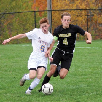 Woodland's Nathaniel Smith (4) and Seymour's Jacek Inglant (9) battle for the ball during a game Oct. 20 at Woodland Regional High School in Beacon Falls. –ELIO GUGLIOTTI