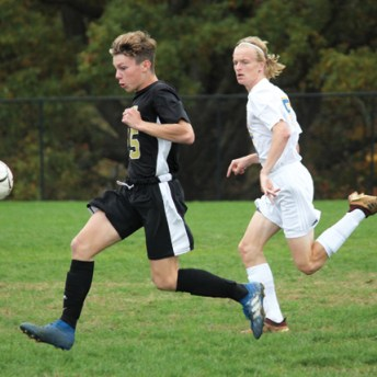 Woodland's Alex Farr (25) tracks down the ball as Seymour's Leotrim Gashi (15) gives chase during a game Oct. 20 at Woodland Regional High School in Beacon Falls. –ELIO GUGLIOTTI