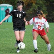 Woodland's Abby Colt (12) fends off Derby's Ariana Martinez (8) to control the ball during a game Oct. 19 at Woodland Regional High School in Beacon Falls. –ELIO GUGLIOTTI