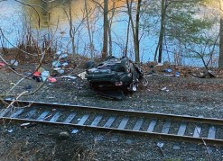 A wrecked Honda Accord lies on its roof near the bank of the Naugatuck River off Cold Spring Road in Beacon Falls on Monday after crashing off Route 8 northbound. -CONTRIBUTED BY BEACON HOSE