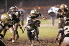 Woodland's Jared Katchmar picks up yards against Ansonia in 2004. –REPUBLICAN-AMERICAN ARCHIVE