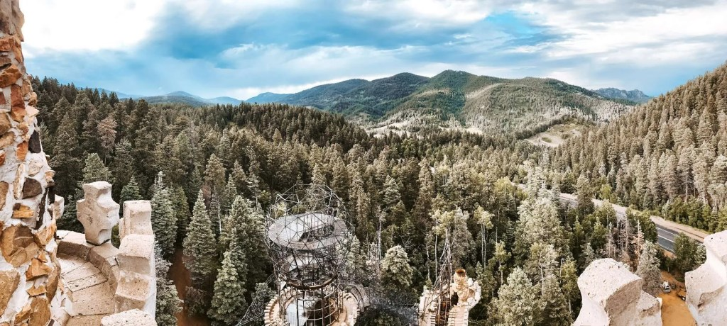 Have you ever wanted to see a castle? Tucked deep in the Colorado mountains, Bishop Castle lays patiently waiting for explorers. Colorado Road trip stops! #traveltips Colorado   USA Road Trips   Across the Country Road Trips   #traveldestinations #travel Colorado Springs   Mountains   Mountain Getaway