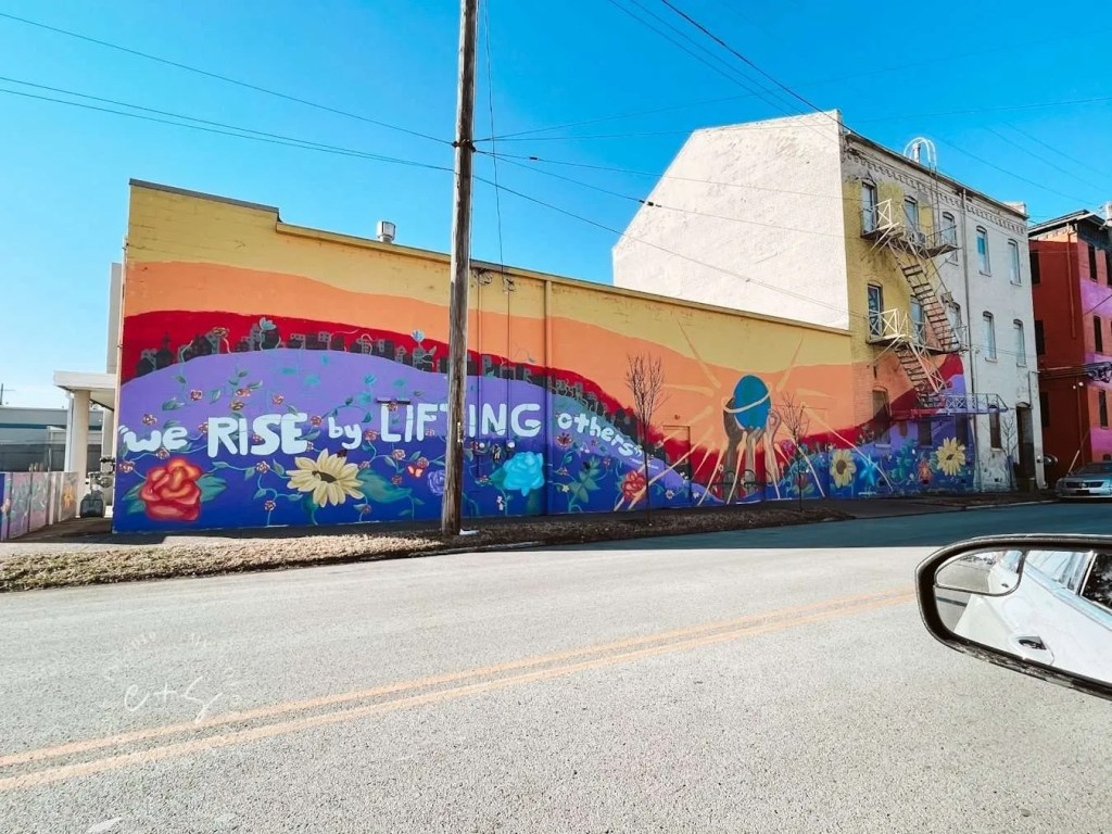 We Rise By Lifting Others Louisville Mural