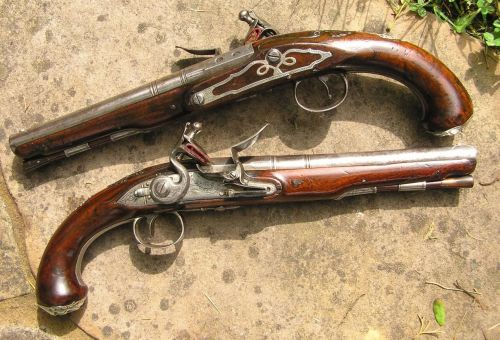 British James Barbar silver-mounted, 22-bore (.60 caliber) holster pistols from 1778