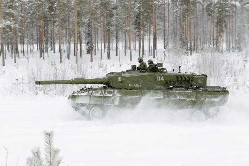 green tank in white snow