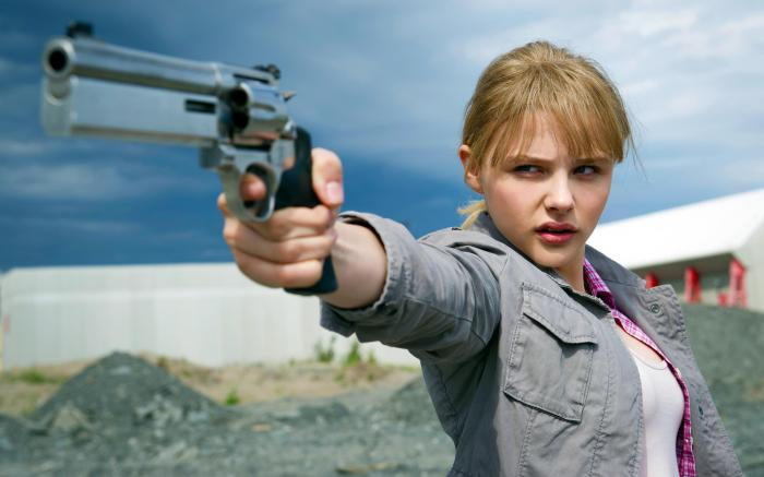 chloe with gun.jpg