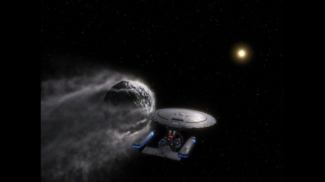 The Enterprise 1701-D Rides Shotgun to an astroid.jpg