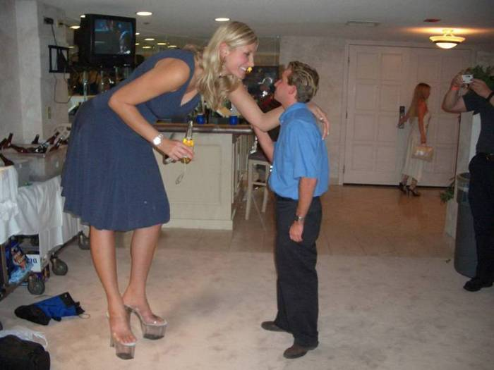 tall woman talking to short man.jpg