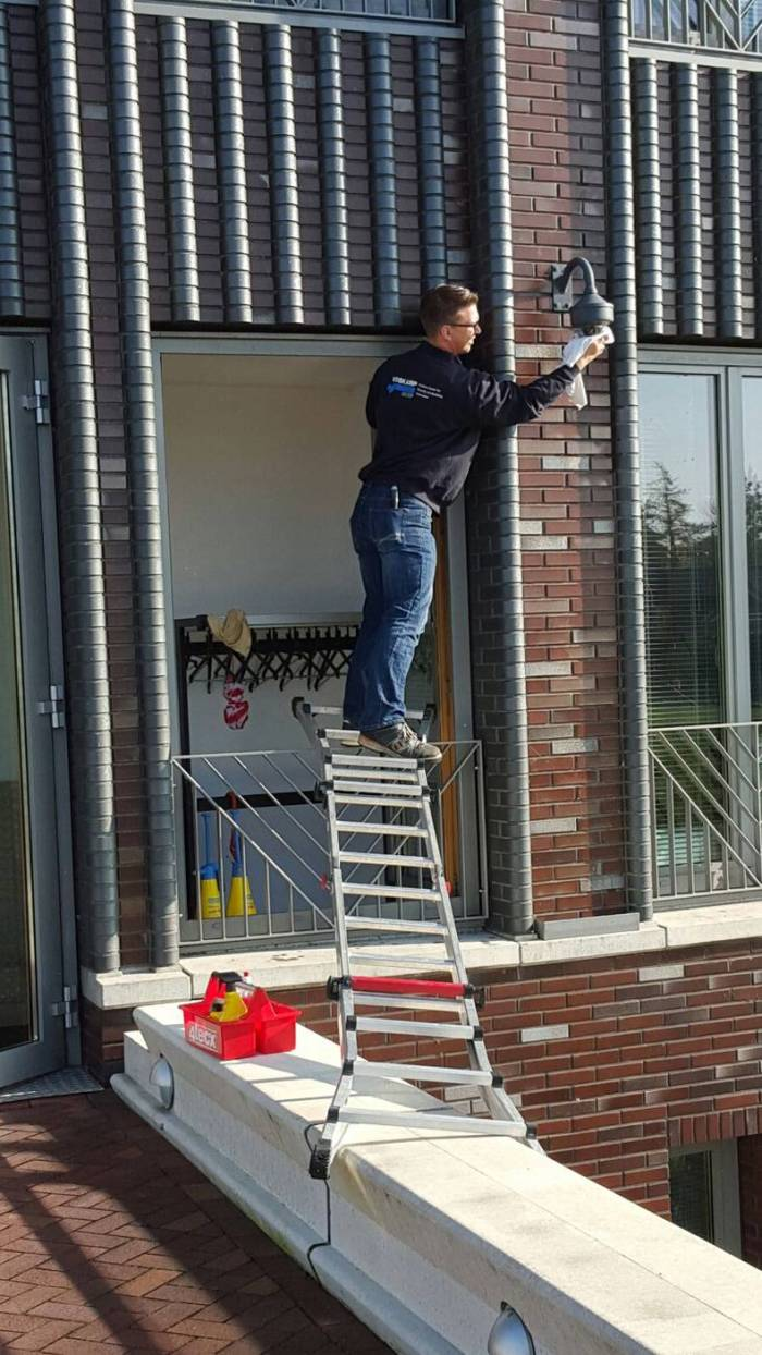 Using a ladder to change a bulb.jpg