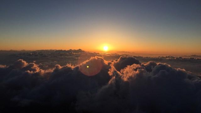 Sunrise Over Clouds.jpg