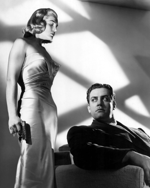 No Merchandising. Editorial Use Only. No Book Cover Usage Mandatory Credit: Photo by Courtesy Everett Collection / Rex Features (2060873a) PITFALL, Lizabeth Scott, Raymond Burr, 1948, gun PITFALL, Lizabeth Scott, Raymond Burr, 1948, gun