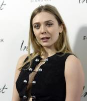 Elizabeth Olsen with her mouth open and her side boob.jpg