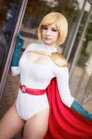 powergirl cosplayer by the window.png