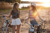 two girls in high shorts by their bikes.jpg