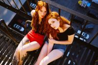 two girls on a fire escape.jpeg
