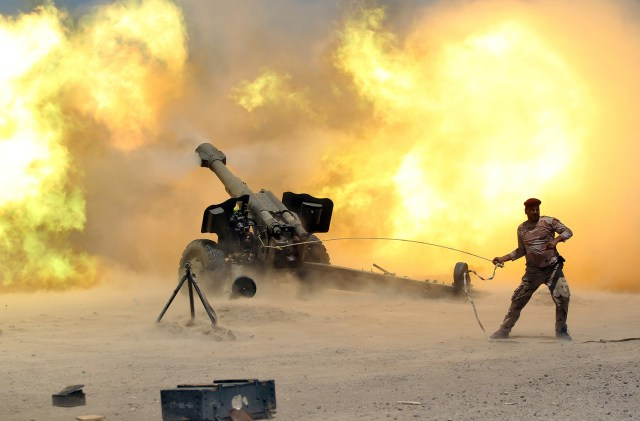 Iraq's security forces fires artillery while not wearing hearing protection.jpg