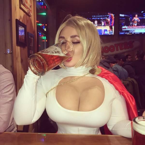 powergirl havinga drink.jpg
