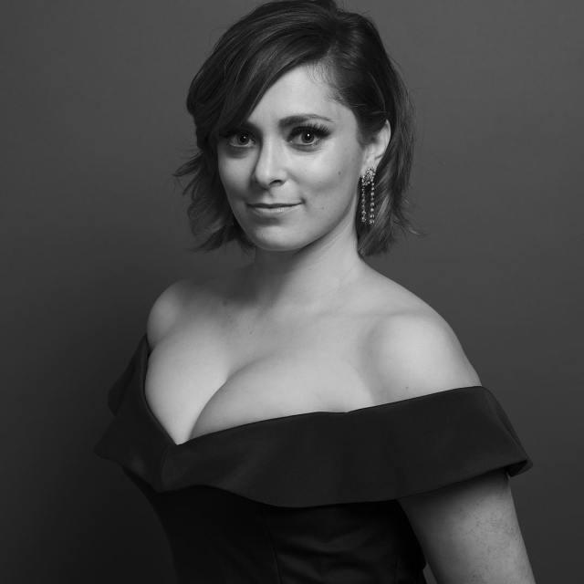 Rachel Bloom in a classy low cut black dress.jpg