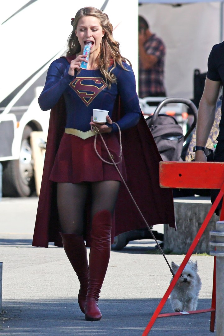 Melissa Benoist eating an icy and walking her dog.jpg