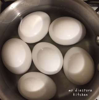 eggs boiling in a saucepan