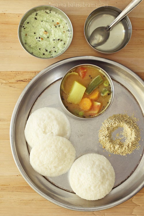 Idlis south indian steamed savoury rice lentil cakes recipe in the good old days when our grandmothers ruled the kitchen batter for idlis and whatever else it was needed for was ground in an aatukallu literally forumfinder Image collections
