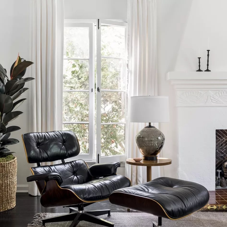 Classic leather recliner chair with matching ottoman.
