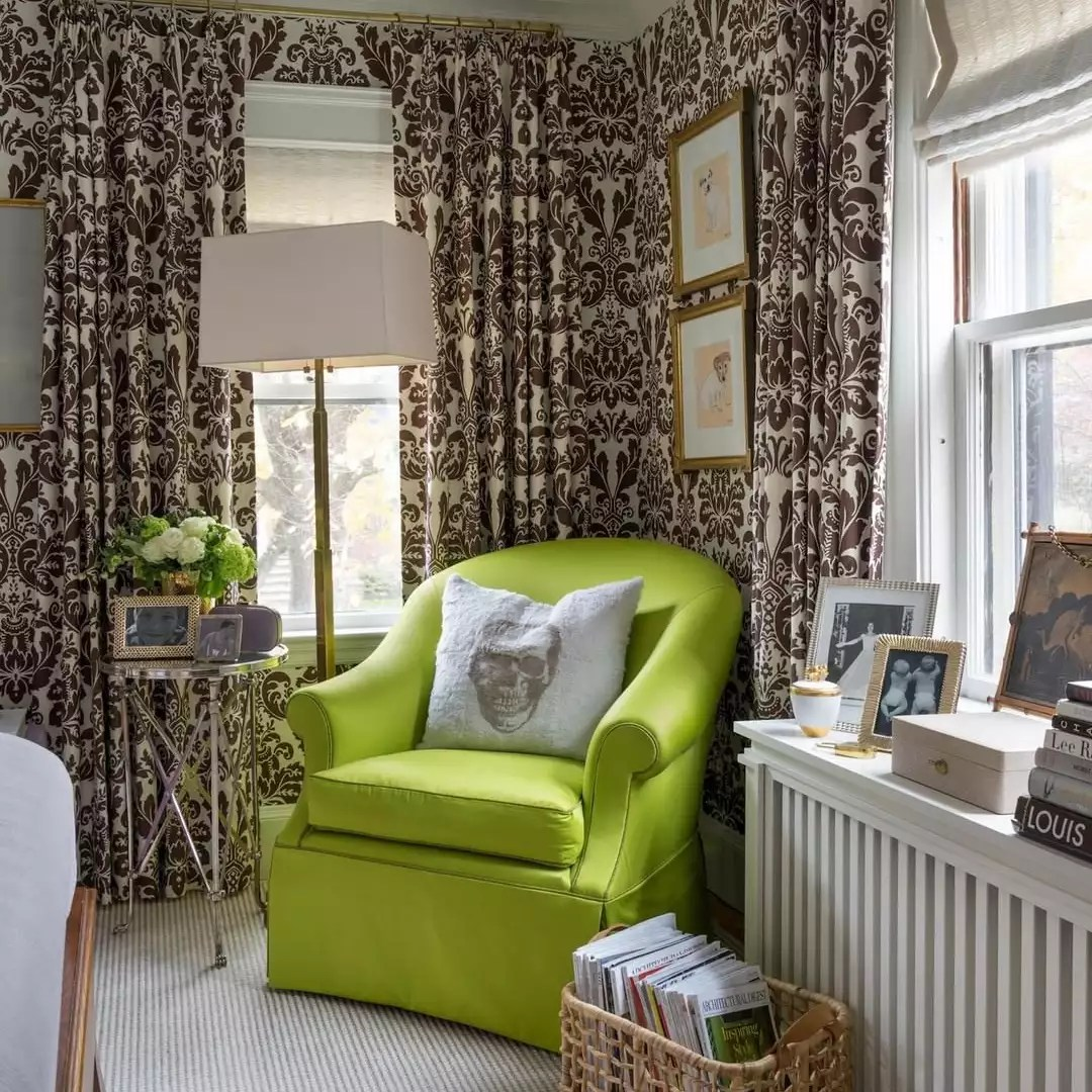 Lime green chair and patterned curtains.