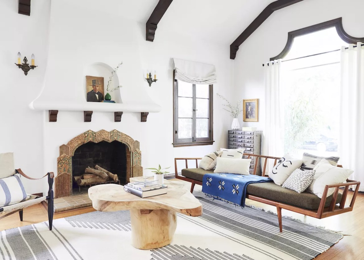 bright open living room with large rug