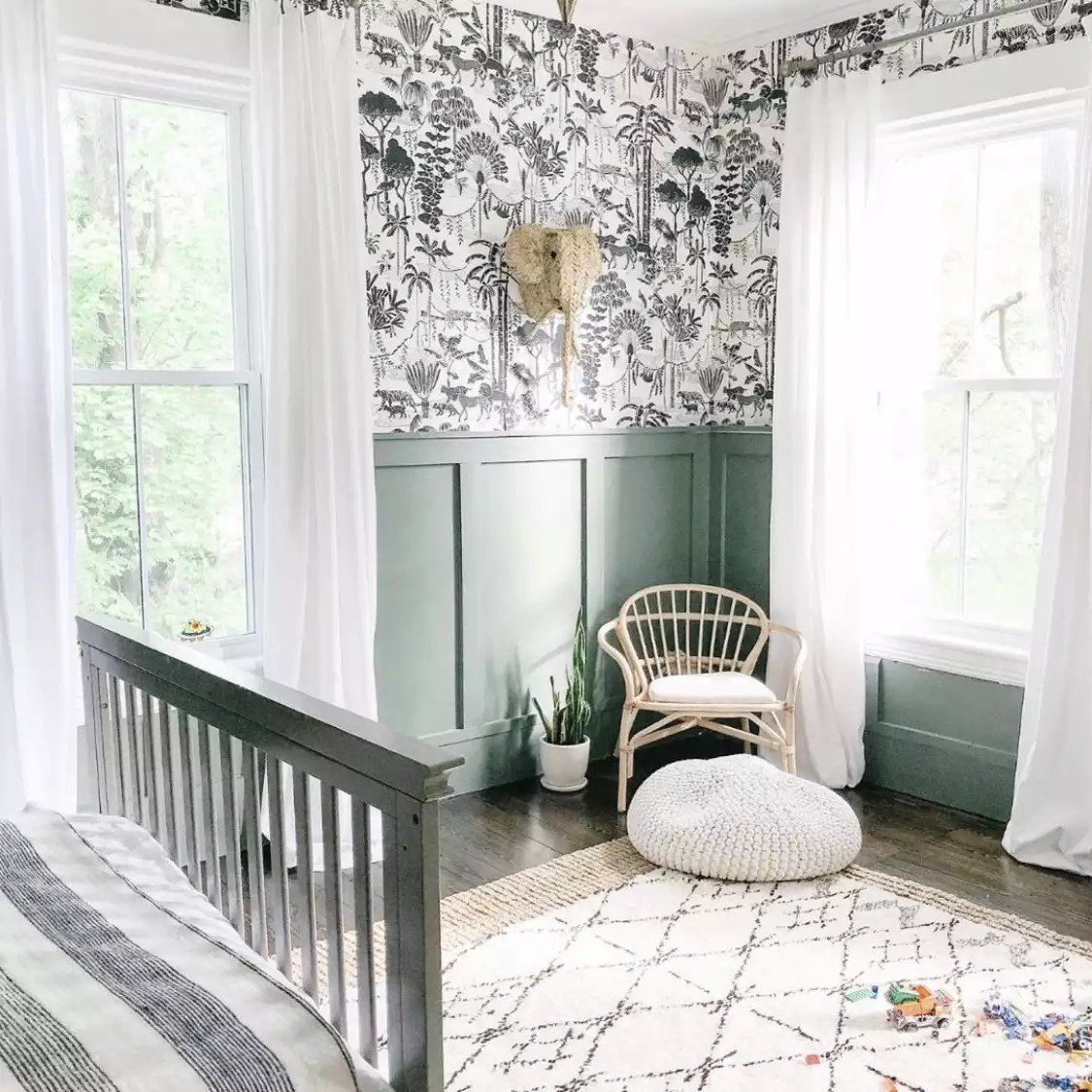 Wallpapered and green bedroom.