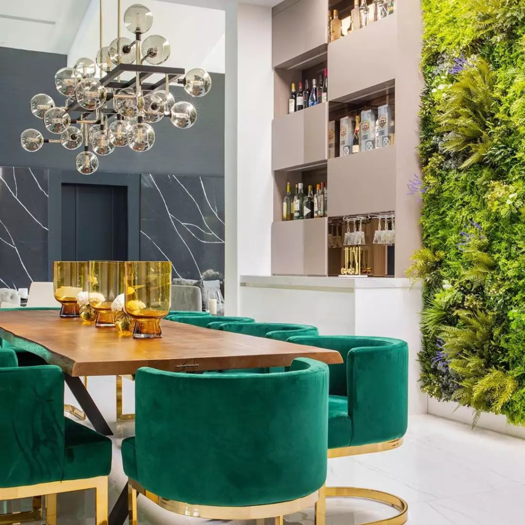 Dining room with green velvet chairs
