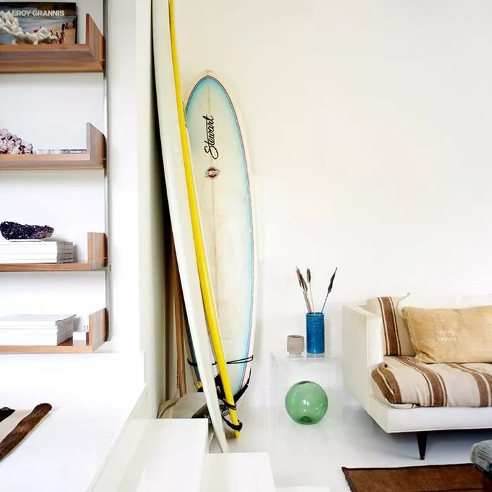 living room with surfboards