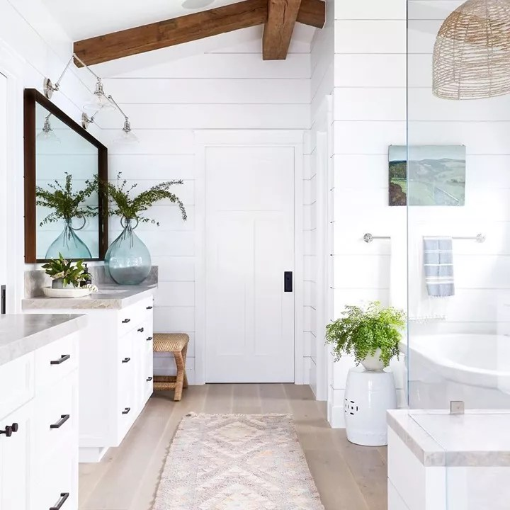 White bathroom with cathedral ceiling