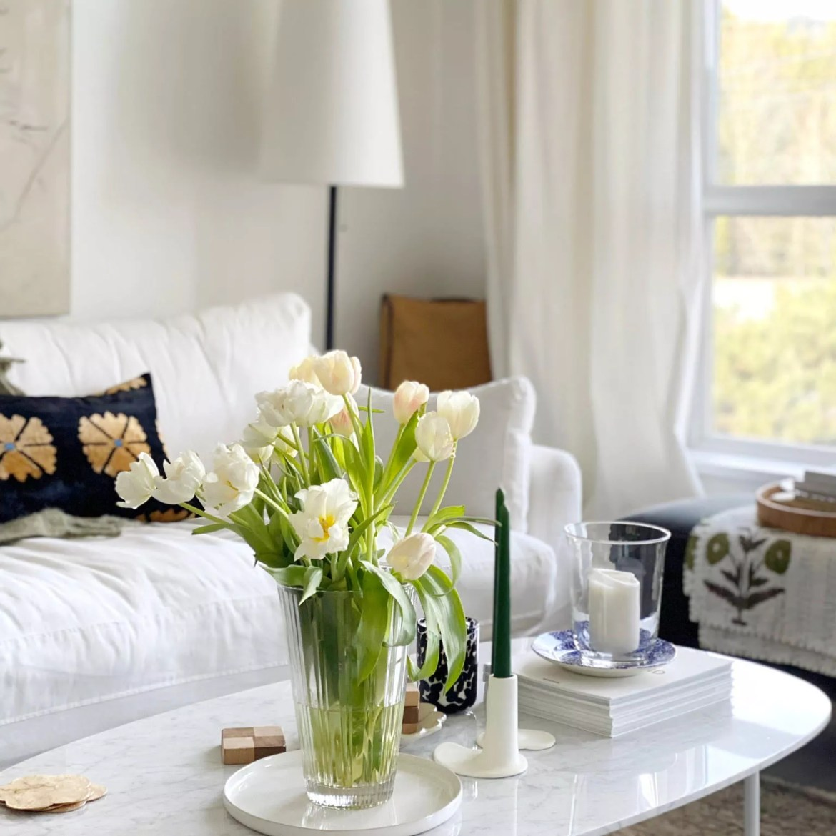 Sunny living space with fresh tulips.