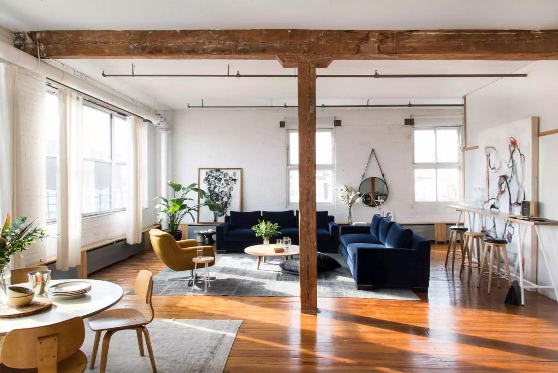 Rustic living room with blue velvet sofas.