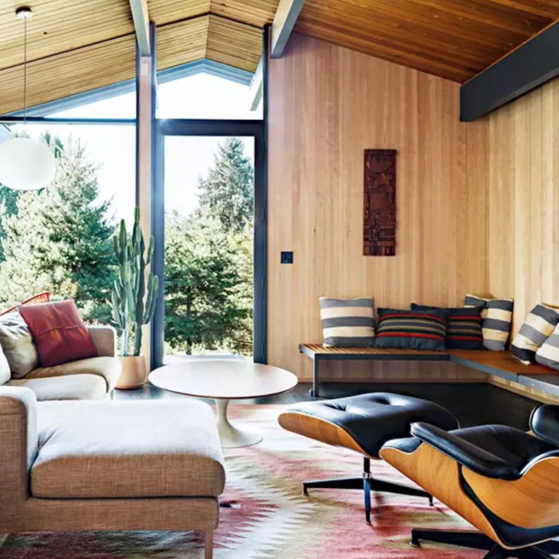 Living room features wood-paneled walls and A-frame roof