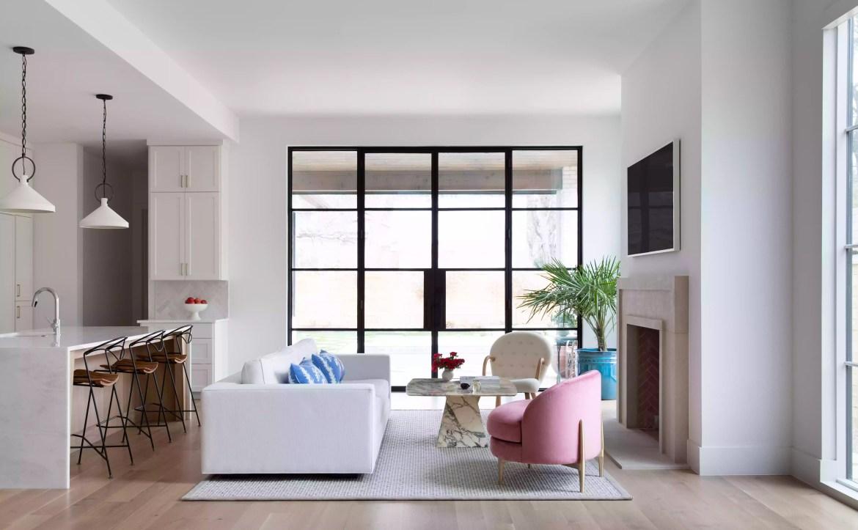 Modern living room with large steel doors.