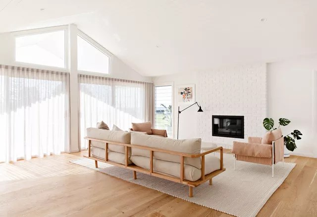 White living room with cathedral ceiling