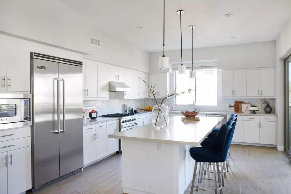 Large open white kitchen.